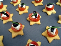 Parmesan shortbread biscuits with roasted tomato, fetta and olive